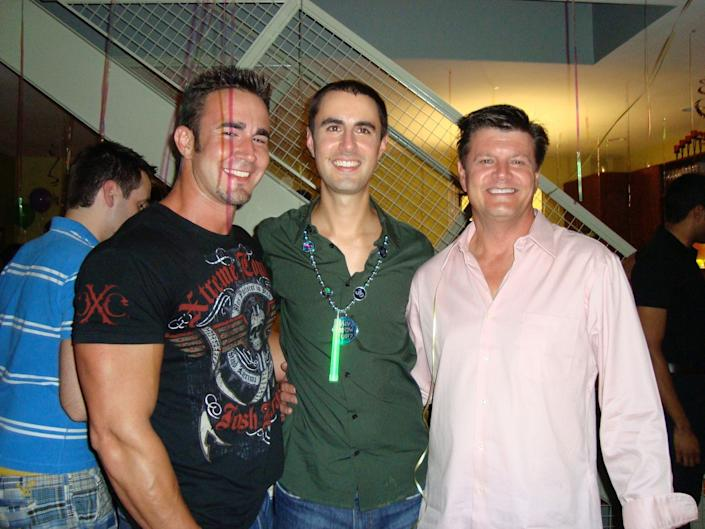 John Grove, left, with his brother Brian, center, and father Bob, right, at a party in 2008. (Photo: Courtesy of Bob Grove)