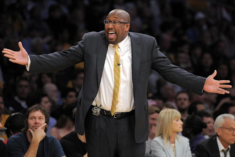 FILE - This March 29, 2012 file photo shows Los Angeles Lakers head coach Mike Brown gesturing during the second half of their NBA basketball game against the Oklahoma City Thunder in Los Angeles. A report from USA Today says the Lakers have fired Brown after a 1-4 start to his second season in charge of the team. The newspaper report Friday, Nov. 9, 2012 cited Brown's agent, Warren Legarie, as the source of the information. (AP Photo/Mark J. Terrill, File)