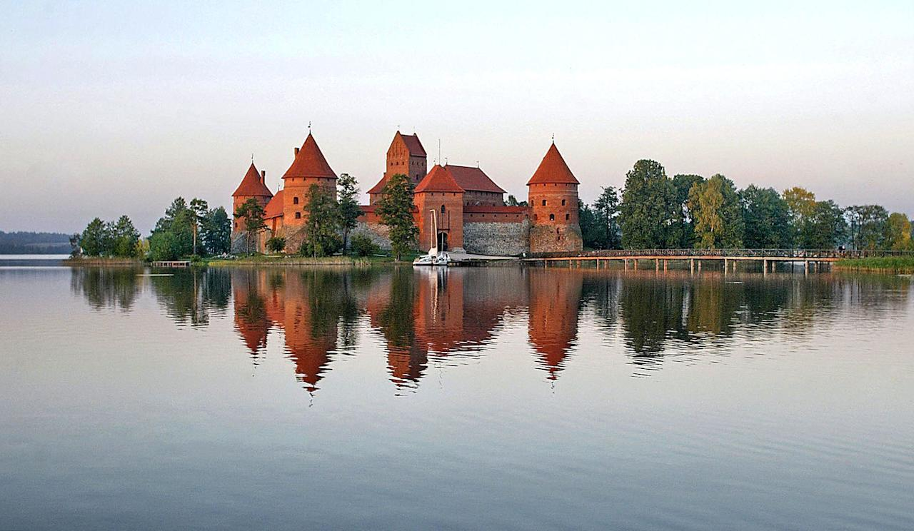 """Reconstructed in the second half of the 14th century, Trakai Island Castle sits on a postcard-perfect island in <a href=""""https://www.cntraveler.com/gallery/road-trip-an-eastern-european-grand-tour?mbid=synd_yahoo_rss"""" target=""""_blank"""">Lithuania</a>'s Lake Galvė. The town of Trakai is only 14 miles west of Vilnius, meaning you can easily drive out to see the castle's Gothic-style architecture, brick-and-stone chapel, and gorgeous surroundings for yourself."""