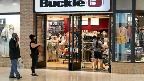 PHOTO: Shoppers wearing protective masks wait in line outside a Buckle store at the Galleria Dallas mall in Dallas, Texas, May 4, 2020. (Cooper Neill/Bloomberg via Getty Images)