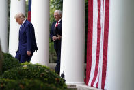 President Donald Trump arrives with Vice President Mike Pence to speak about coronavirus testing during an event in the Rose Garden of the White House, Monday, Sept. 28, 2020, in Washington. (AP Photo/Evan Vucci)