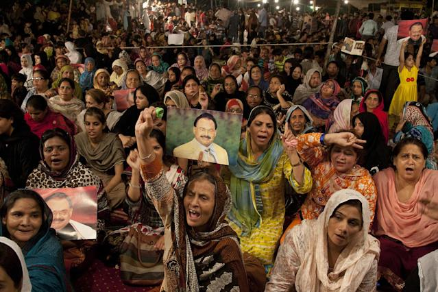 <p>Supporters of the Muttahida Qaumi Movement, or MQM, one of Pakistan's major political parties, attend a sit in protest condemning the arrest in London of its leader, Altaf Hussain, in Islamabad, Pakistan, June 4, 2014. (AP Photo/Shakil Adil) </p>