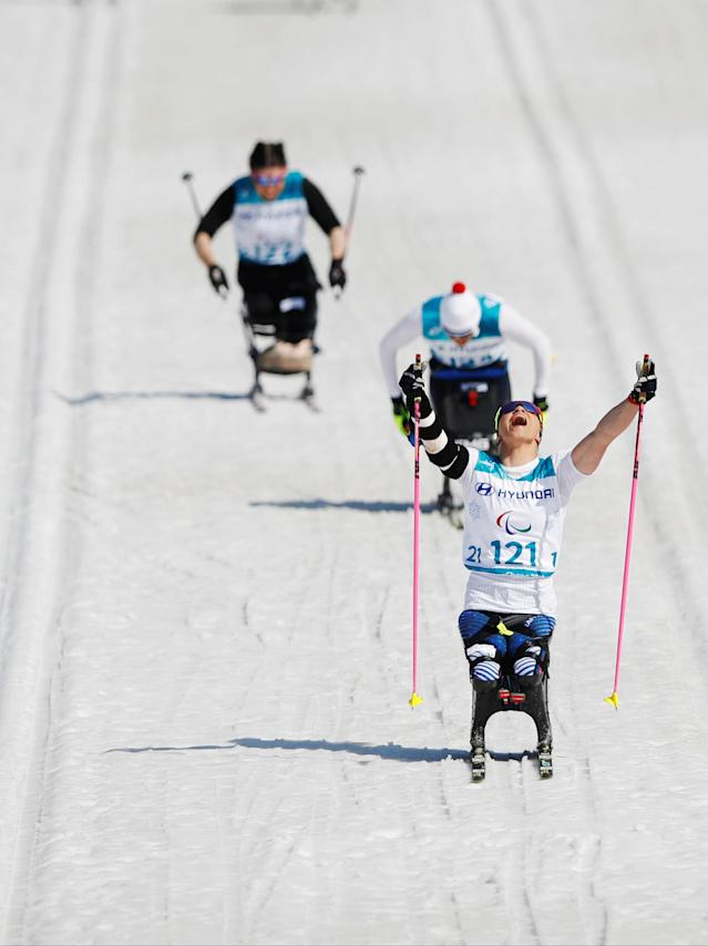 Cross-Country Skiing - Pyeongchang 2018 Winter Paralympics - Women's 1.1km Sprint - Sitting - Final - Alpensia Biathlon Centre - Pyeongchang, South Korea - March 14, 2018 - Oksana Masters of the U.S. celebrates winning gold. REUTERS/Carl Recine