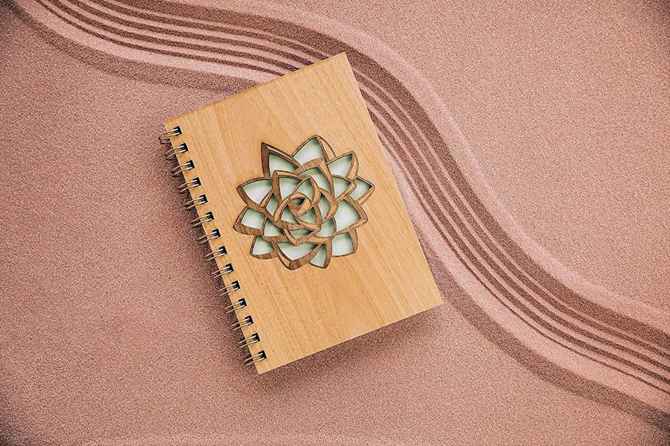 <p>This <span>Succulent Wood Journal</span> ($29) is great for self-reflection, bullet journaling, and more.</p>
