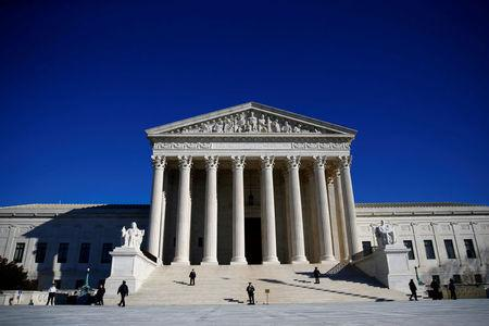 FILE PHOTO: Police officers stand in front of the U.S. Supreme Court in Washington