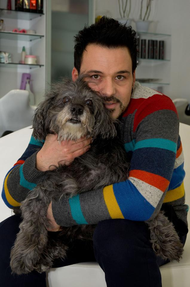 PIC FROM MILESTONE MEDIA / CATERS NEWS - (Pictured Omar Mozzi with Sissy) - A poorly pup has been given a new LEASH of life after an extremely rare blood transfusion with a fellow pooch. Sissy, an 18-year-old mongrel was saved from the brink of death thanks to Sandy the Pitbull who stepped in to save the plucky pup. Despite beating mammary cancer following an operation last Summer, Sissy was struck down with ill health again after recently being diagnosed with anaemia. SEE CATERS COPY. ** UK, USA AND AUSTRALIA USE AND SALES ONLY **