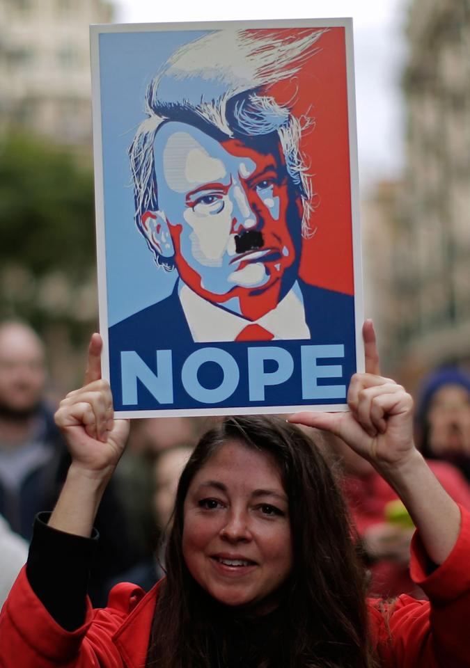 <p>A woman holds a cartoon depicting Donald Trump during the Women's March rally in Barcelona, Spain, Saturday, Jan. 21, 2017. The march was held in solidarity with the Women's March on Washington, advocating women's rights and opposing Donald Trump's presidency. (AP Photo/Manu Fernandez) </p>