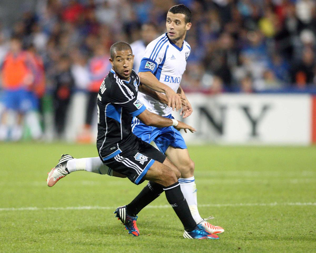 MONTREAL, CANADA - AUGUST 18:  Felipe Martins #7 of the Montreal Impact battles for position with Justin Morrow #15 of the San Jose Earthquakes during the match at the Saputo Stadium on August 18, 2012 in Montreal, Quebec, Canada.  The Impact defeated the Earthquakes 3-1.  (Photo by Richard Wolowicz/Getty Images)