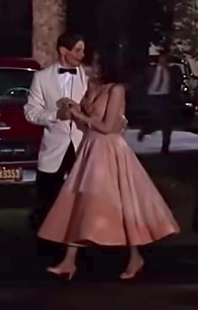 Lorainne wearing a strapless fit and flare dress