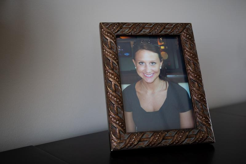 A framed picture of Lara Gass taken by her father, Jay Gass, in 2011 at a restaurant celebrating her brother's college graduation in Nashville, Tenn., photographed in Ponte Vedra Beach, Fla., on March 18, 2019. Lara Gass died at age 27 on March 18, 2014, in a car crash caused by a faulty ignition switch.
