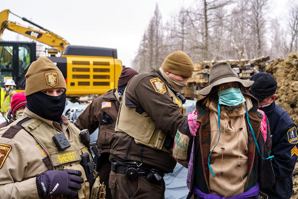 """Sheriffs in Aitkin County, Minnesota, arrest """"water protectors"""" during a protest at the construction site of the Line 3 oil pipeline. (Photo: Kerem Yucel/AFP/Getty Images)"""