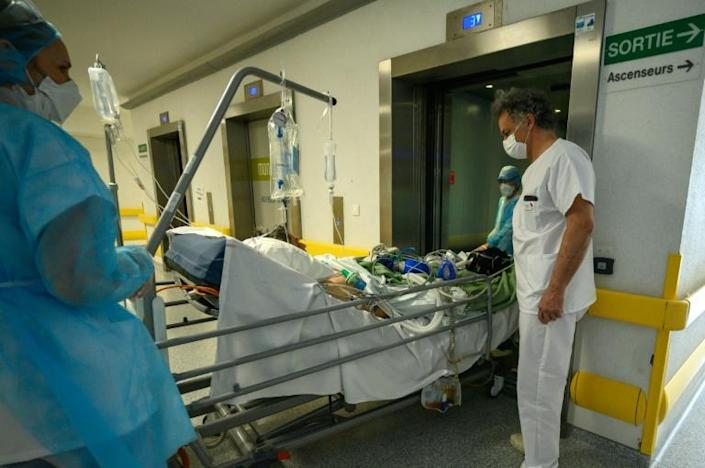 Hospitals faced with surging cases of COVID-19 are postponing non-emergency operations (AFP Photo/PATRICK HERTZOG)