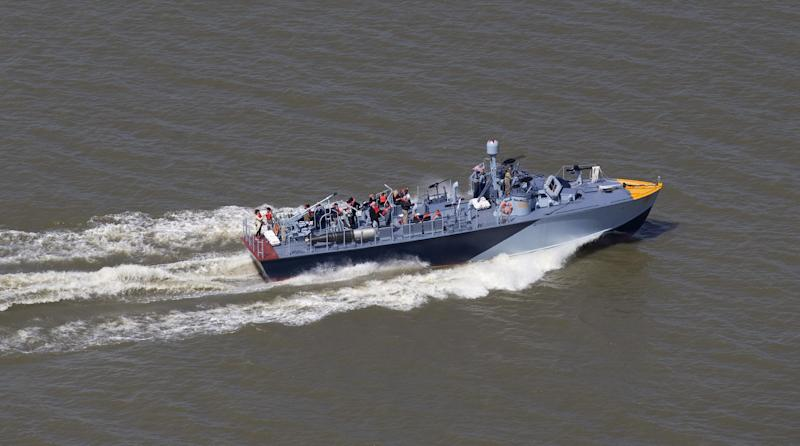 The PT 305, which was restored by the National WWII Museum, cruises with guests of the museum Thursday, March 16, 2017, on Lake Pontchartrain, where she was originally tested by Higgins Industries more than 70 years ago, in New Orleans. The U.S. Navy PT boat that sank three vessels and saw action in Europe in World War II is back in New Orleans where it was built, what historians describe as the nation's only fully restored combat ship of that type from the era. Its return to water is the culmination of a 10-year restoration project by the museum. (AP Photo/Gerald Herbert)