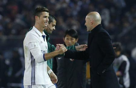 Football Soccer - Real Madrid v Kashima Antlers - FIFA Club World Cup Final - International Stadium Yokohama - Japan , 18/12/16 Real Madrid's Cristiano Ronaldo with Real Madrid coach Zinedine Zidane after being substituted Reuters / Kim Kyung-Hoon Livepic