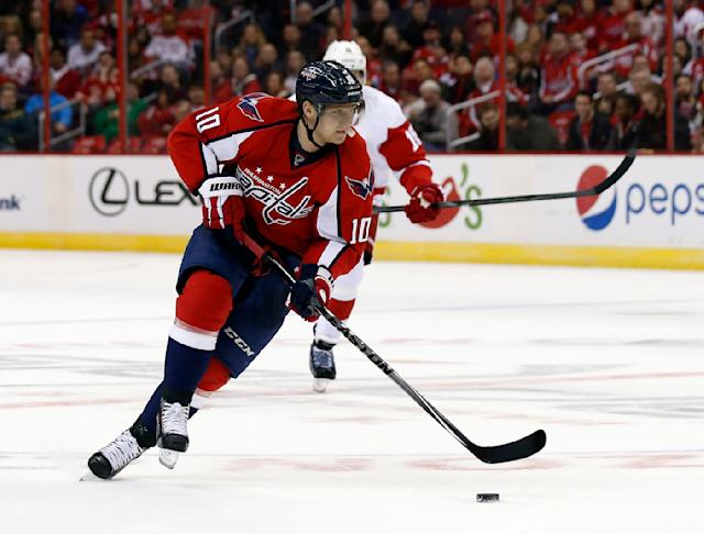 Washington Capitals left wing Martin Erat (10), Czech Republic, skates with the puck in the first period of an NHL hockey game against the Detroit Red Wings, Sunday, Feb. 2, 2014, in Washington. (AP Photo/Alex Brandon)