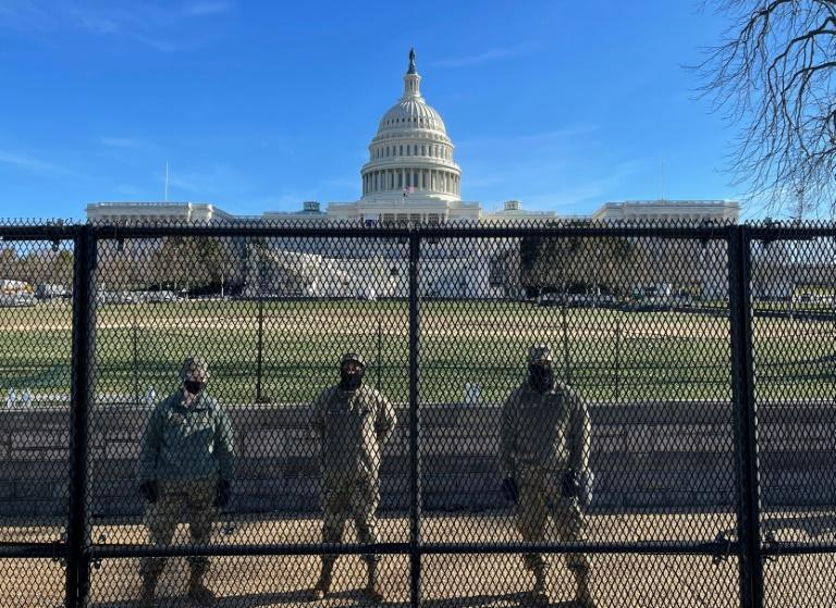 National Guard troops at the new security fence around the US Capitol erected ahead Joe Biden's inauguration