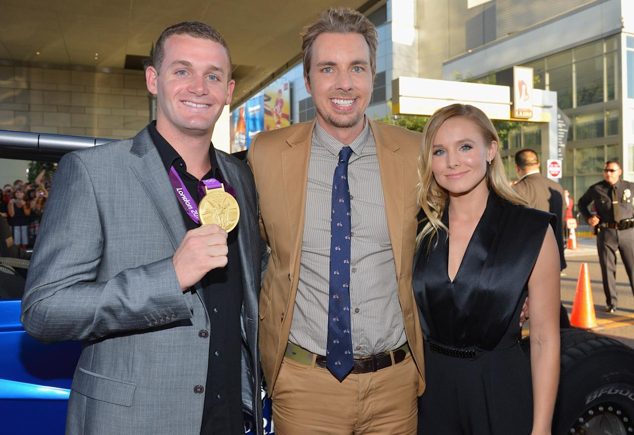 """LOS ANGELES, CA - AUGUST 14:  Olympic swimmer Tyler Clary, actor Dax Shepard and actress Kristen Bell arrive to the premiere of Open Road Films' """"Hit and Run"""" on August 14, 2012 in Los Angeles, California.  (Photo by Alberto E. Rodriguez/Getty Images)"""