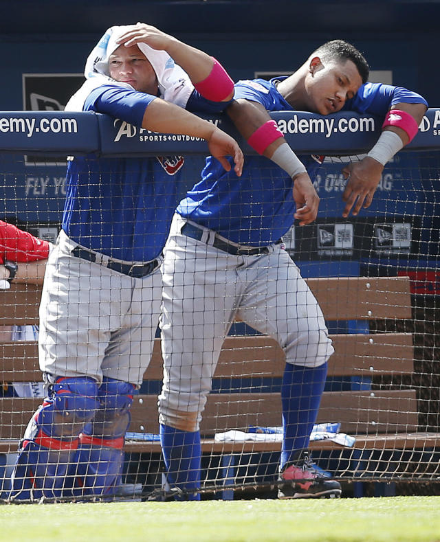 Chicago Cubs catcher Welington Castillo, left, and shortstop Starlin Castro, right, lean against the dugout railing as they watch the top of the ninth inning of a baseball game against the Atlanta Braves, Sunday, May 11, 2014, in Atlanta. Atlanta won 5-2. (AP Photo/John Bazemore)