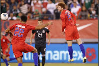 In this photo taken Sept. 6, 2019, United States forward Josh Sargent, right, goes airborne while passing the ball to a teammate in the second half of an international friendly soccer match against Mexico in East Rutherford, N.J. After scoring his first goal of the season for Werder Bermen with a spectacular shot, 19-year-old Sargent hopes to play for the United States in his hometown during Tuesday's exhibition against Uruguay at Busch Stadium. (AP Photo/Kathy Willens)