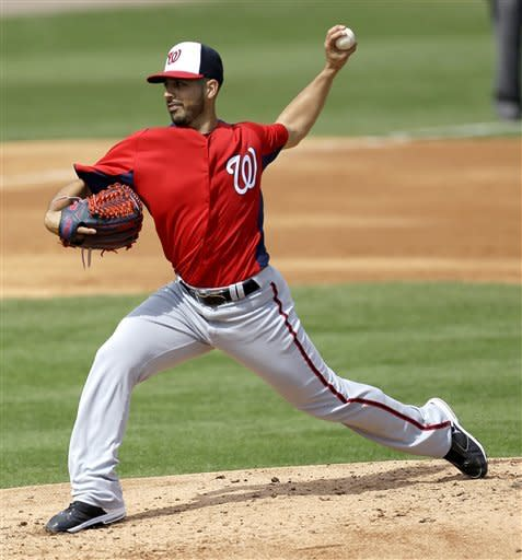 Washington Nationals pitcher Gio Gonzalez throws a pitch during the second inning of an exhibition spring training baseball game against the St. Louis Cardinals, Saturday, March 2, 2013, in Jupiter, Fla. (AP Photo/Julio Cortez)