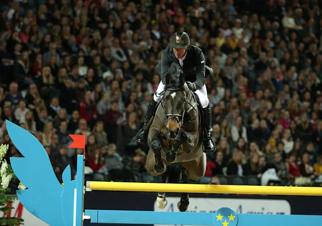 Equestrian - Sweden International Horse Show - International jumping - Qualification for Sweden Masters - Friends Arena, Stockholm, Sweden - December 1, 2017. Jur Vrieling of Netherlands on his horse Zypern III jumps. TT News Agency/Soren Andersson/via REUTERS ATTENTION EDITORS - THIS IMAGE WAS PROVIDED BY A THIRD PARTY. SWEDEN OUT. NO COMMERCIAL OR EDITORIAL SALES IN SWEDEN