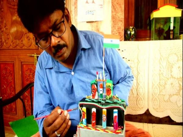 Coimbatore based miniature artist, Raja draws images of freedom fighters on cell batteries. (Photo/ANI)