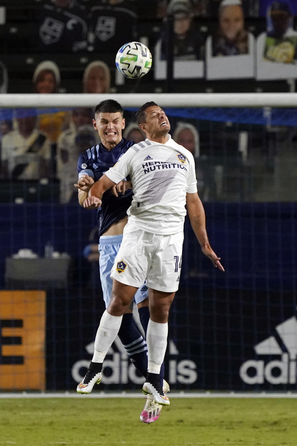 Los Angeles Galaxy's Javier Hernandez, front, goes up for a header as Vancouver Whitecaps's Ranko Veselinovic defends during the second half of an MLS soccer match, Sunday, Oct. 18, 2020, in Carson, Calif. (AP Photo/Marcio Jose Sanchez)