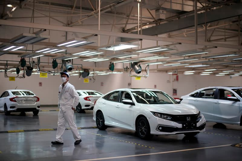 Employee is seen on a production line inside a Dongfeng Honda factory in Wuhan