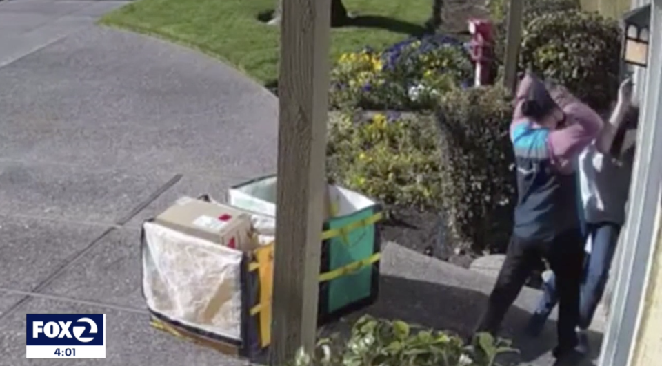 An Amazon delivery driver is seen repeatedly hitting a woman in security camera video.