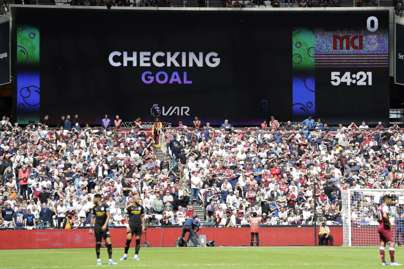 Players wait while a possible goal by Manchester City's Gabriel Jesus is checked by VAR during the English Premier League soccer match between West Ham United and Manchester City at London stadium in London, Saturday, Aug. 10, 2019. The goal was disallowed. (AP Photo/Kirsty Wigglesworth)