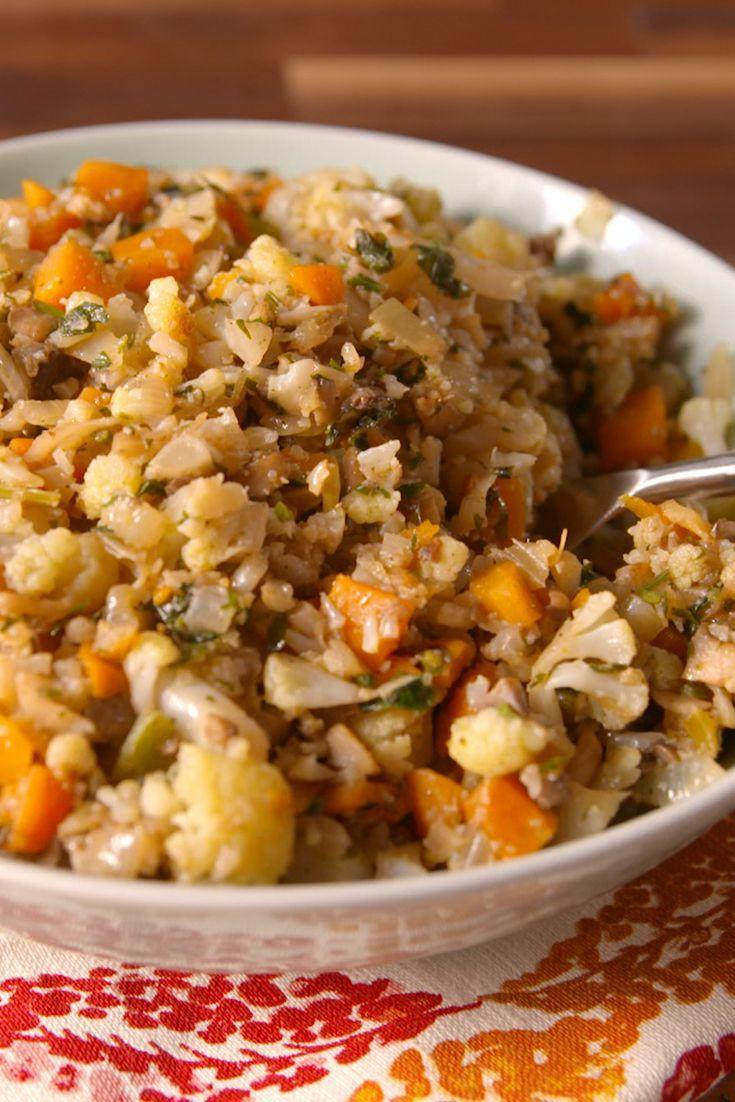 """<p>Cauliflower takes the place of bread in the low-carb stuffing of your dreams.</p><p>Get the recipe from <a href=""""https://www.delish.com/cooking/recipe-ideas/recipes/a50127/cauliflower-stuffing-recipe/"""" rel=""""nofollow noopener"""" target=""""_blank"""" data-ylk=""""slk:Delish"""" class=""""link rapid-noclick-resp"""">Delish</a>.</p>"""