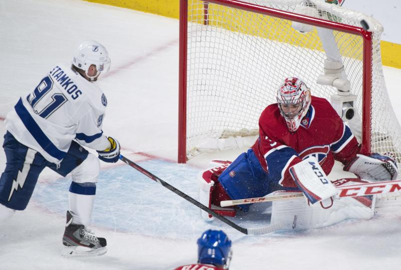 Montreal Canadiens' goalie Carey Price makes a save on Tampa Bay Lightning's Steven Stamkos during first period of the first round NHL Stanley Cup playoff hockey in Montreal, Sunday, April 20, 2014. (AP Photo/The Canadian Press, Graham Hughes)