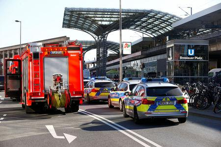 German police vehicles are parked near the main train station in Cologne, Germany, October 15, 2018, after the train station was closed after hostage-taking.     REUTERS/Thilo Schmuelgen