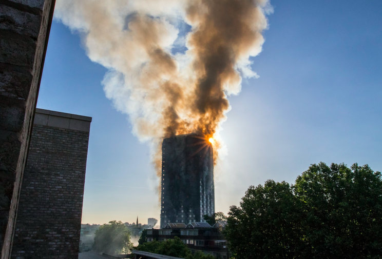 Smoke billowed from the Grenfell Tower on Wednesday morning (Picture: PA)