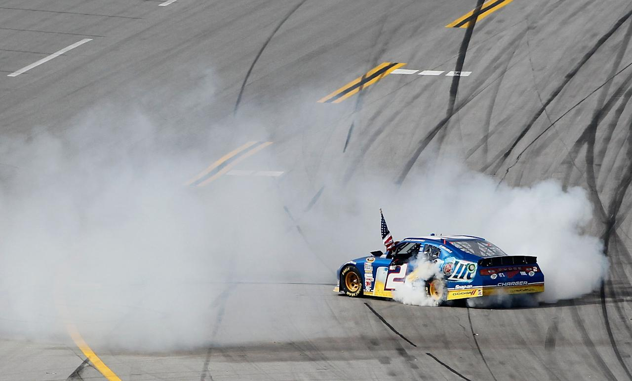 TALLADEGA, AL - MAY 06:  Brad Keselowski, driver of the #2 Miller Lite Dodge, celebrates with a burnout after winning the NASCAR Sprint Cup Series Aaron's 499 at Talladega Superspeedway on May 6, 2012 in Talladega, Alabama.  (Photo by Kevin C. Cox/Getty Images for NASCAR)
