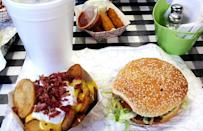 <p>Residents of Wood River, Illinois, flock to King Louie's Drive-In for the burgers, like the King Louie burger, which comes with all the classic trimmings. No burger is complete without a side of the famous potato planks, which are somewhere between a steak fry and a classic french fry. If you dare, you can attempt the King of the Jungle Challenge, which consists of a 2-pound burger, loaded potato planks and a 32-ounce soda of your choice. If you finish the monstrous meal in 30 minutes, you get your photo on the wall and a free T-shirt.</p>