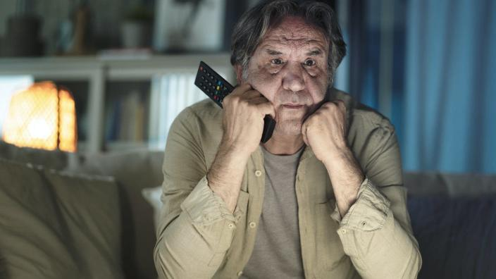"""<span class=""""caption"""">Watching too much COVID-19 coverage can make your fear and worry even worse.</span> <span class=""""attribution""""><a class=""""link rapid-noclick-resp"""" href=""""https://www.gettyimages.com/detail/photo/man-watching-tv-at-home-royalty-free-image/1182894920?adppopup=true"""" rel=""""nofollow noopener"""" target=""""_blank"""" data-ylk=""""slk:seb_ra via Getty Images"""">seb_ra via Getty Images</a></span>"""