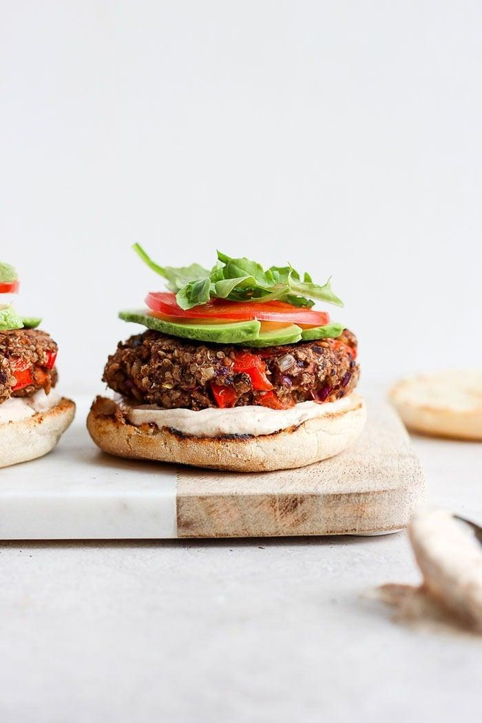 "<p>Made with roasted garlic and veggies, these black bean burgers pack a hearty punch of protein. Top 'em off with onions, tomatoes, and fresh lettuce for best results.</p> <p><strong>Get the recipe</strong>: <a href=""https://fitfoodiefinds.com/roasted-garlic-black-bean-quinoa-burger/"" class=""link rapid-noclick-resp"" rel=""nofollow noopener"" target=""_blank"" data-ylk=""slk:roasted garlic black bean quinoa burgers"">roasted garlic black bean quinoa burgers</a></p>"