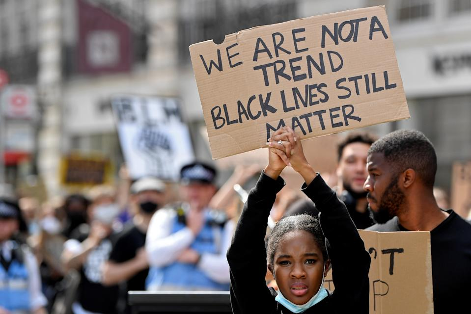 A protestors holds up a sign during a Black Lives Matter march in London, Britain, June 28, 2020. REUTERS/Toby Melville     TPX IMAGES OF THE DAY