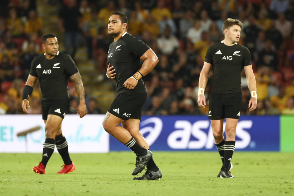 New Zealand's Ofa Tuungafasi, centre, walks from the field after he was sent off during the Bledisloe rugby test between Australia and New Zealand at Suncorp Stadium, Brisbane, Australia, Saturday, Nov.7, 2020. (AP Photo/Tertius Pickard)