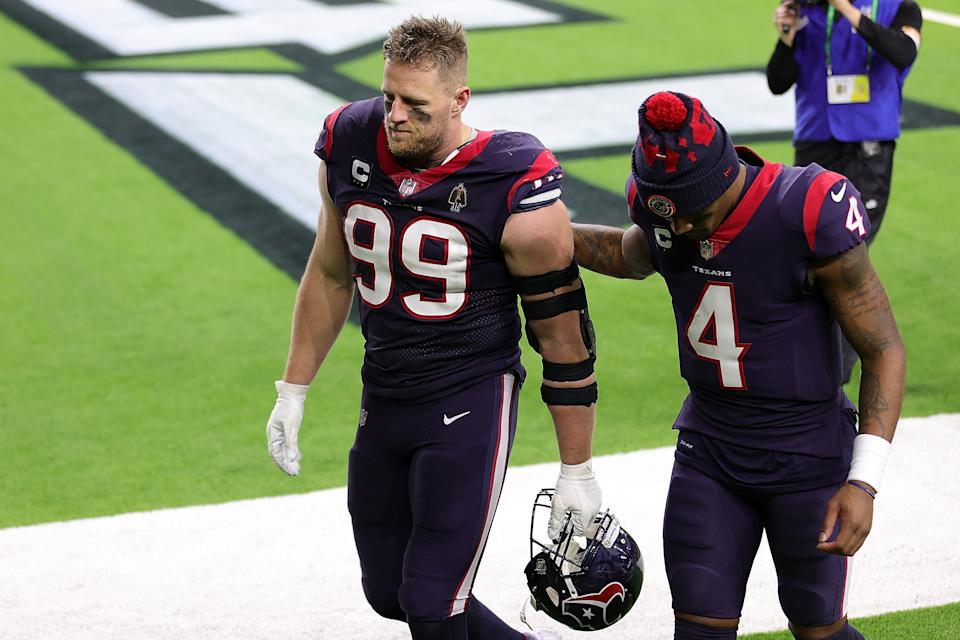 J.J. Watt walks off the field with Deshaun Watson.