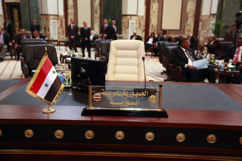 The empty seat of the Syrian President Bashar Assad is seen during the Arab League summit in Baghdad, Iraq, Thursday, March, 29, 2012. The annual Arab summit meeting opened in the Iraqi capital Baghdad on Thursday with only 10 of the leaders of the 22-member Arab League in attendance and amid a growing rift between Arab countries over how far they should go to end the one-year conflict in Syria.  (AP Photo/Karim Kadim)