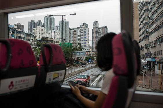 Gigi takes a bus from the Tuen Mun neighbourhood to Tsim Sha Tsui, where she will take a ferry to Hong Kong island to join the protest (Nicole Tung/Washington Post)