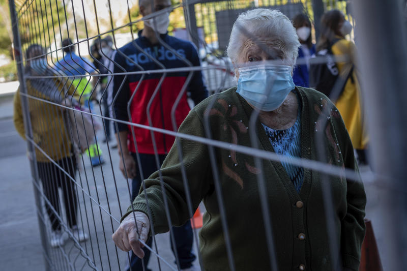 Madrid to obey new virus rules but will fight them in court