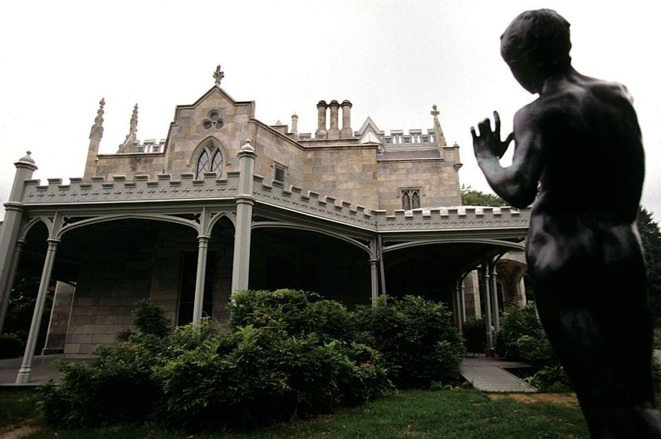 """<p>This spooky Gothic Revival mansion, built in 1838, was once the home of railroad tycoon Jay Gould. It sits on 67 acres and overlooks the Hudson River. The National Historic Landmark home was used as a filming location for <em>The Blacklist, Project Runway, House of Dark Shadows, </em>and <em>Night of Dark Shadows,</em> to name a few. Former owner Jay Gould had a 243-foot yacht built so that he didn't have to take the nearby railroad built by his archnemesis, Cornelius Vanderbilt. Talk about rich people problems...</p><p><a class=""""link rapid-noclick-resp"""" href=""""http://lyndhurst.org/about/virtual-tours/"""" rel=""""nofollow noopener"""" target=""""_blank"""" data-ylk=""""slk:TOUR NOW"""">TOUR NOW </a></p>"""