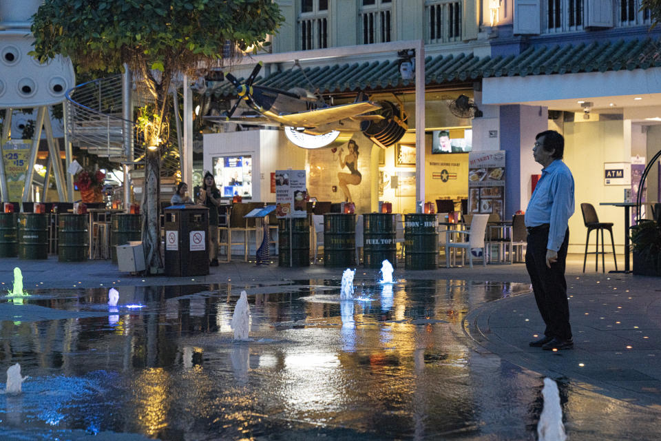 SINGAPORE, SINGAPORE - MARCH 30: A man looks at the water fountain in Clarke Quay on March 30 2020 in Singapore. The usually popular drinking area has seen less crowd since the Singapore government shut down all entertainment venues such as bars, karaoke lounges, nightclubs and introduced several safe distancing measures to curb the spread of COVID-19. The Coronavirus (COVID-19) pandemic has spread to many countries across the world, claiming over 20,000 lives and infecting hundreds of thousands more. (Photo by Ore Huiying/Getty Images)