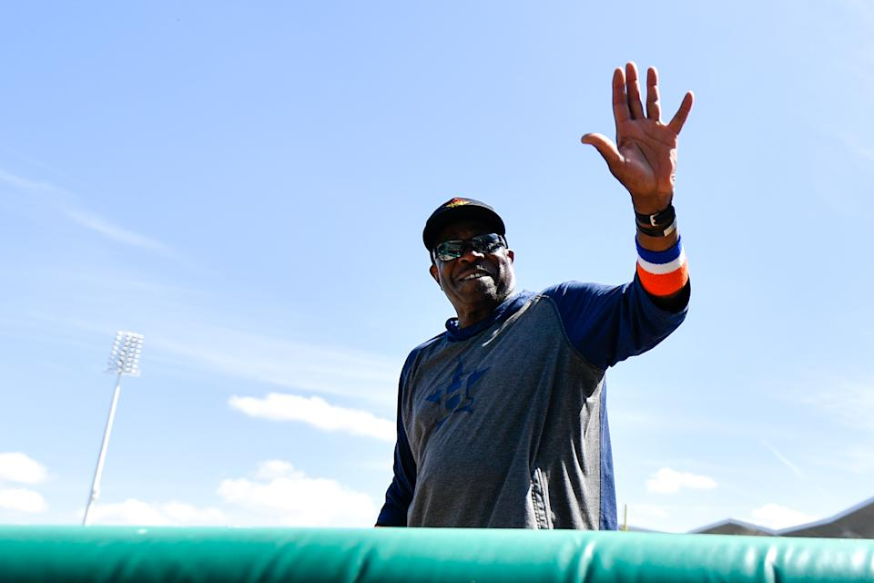 Mar 5, 2020; Fort Myers, Florida, USA; Houston Astros manager Dusty Baker (12) waves to fans prior to the game against the Boston Red Sox during spring training at JetBlue Park. Mandatory Credit: Douglas DeFelice-USA TODAY Sports