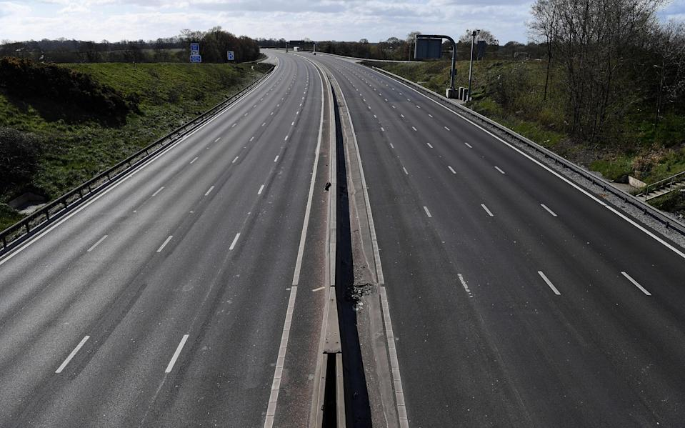 """The empty M6 motorway is pictured from junction 18, near Middlewich, north west England on March 29, 2020, as life in Britain continues during the nationwide lockdown to combat the novel coronavirus pandemic. - Prime Minister Boris Johnson warned Saturday the coronavirus outbreak will get worse before it gets better, as the number of deaths in Britain rose 260 in one day to over 1,000. The Conservative leader, who himself tested positive for COVID-19 this week, issued the warning in a leaflet being sent to all UK households explaining how their actions can help limit the spread. """"We know things will get worse before they get better,"""" Johnson wrote. (Photo by Paul ELLIS / AFP) (Photo by PAUL ELLIS/AFP via Getty Images)"""