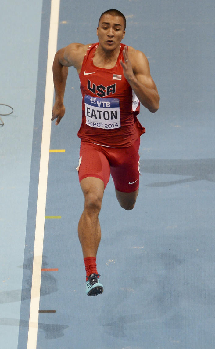 United States' Ashton Eaton competes in the 60m of the men's heptathlon during the Athletics Indoor World Championships in Sopot, Poland, Friday, March 7, 2014. (AP Photo/Alik Keplicz)