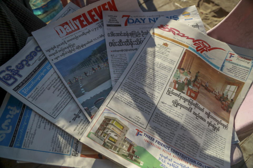 """FILE - In this Feb. 2, 2021, file photo, local newspapers are displayed in a newspaper stall in Yangon, Myanmar. The front page of Standard Time Daily, right, reads """"Meeting of National Defence and Security Council held in Naypyitaw."""" Myanmar's military-controlled government is seeking to suppressing media coverage of protests against their seizure of power as journalists and ordinary citizens strive to keep people inside and outside of the country informed about what is happening. (AP Photo/File)"""
